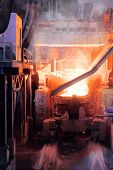 Close Up Of Steel-making Furnace In Smelting Steel Plant. poster