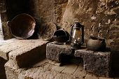 Old Kitchen with stone stove and kitchenwares