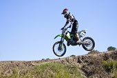 pic of moto-x  - Fast pace motocross race one man in the lead