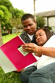 African American Couple Reading Book Outdoor 2 poster