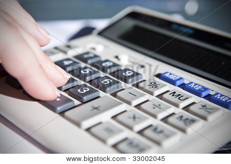 Hand Touching Calculator In Office