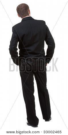 Vista traseira do homem de negócios olha em frente. Rapaz em terno preto assistindo.Coleção de pessoas de vista traseira