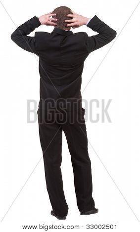 Back view of shocked business man in black suit . Upset adult businessman. Rear view people collection.  backside view of person.  Isolated over white background.