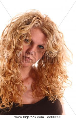 Portrait Of A Woman With Long Blonde Curly Hair