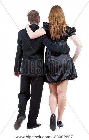 Back view of going young business couple (man and woman) . walking beautiful friendly girl in dress, guy in suit. Rear view people collection.  backside view of person.  Isolated over white background