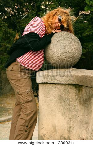Pregnant Woman By A Stone Sphere