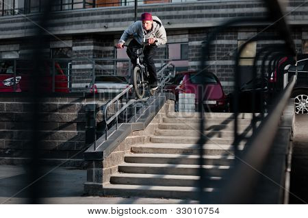 Biker Doing Double Peg Grind