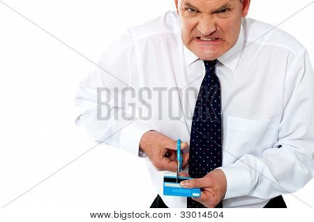Frustrated Businessman Cutting His Credit Card