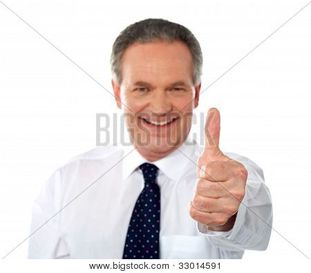 Matured Businessman Gesturing Thumbs-up