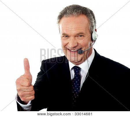 Call Centre Executive Smiling With Thumbs-up