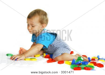 Baby Boy Playing With Puzzle
