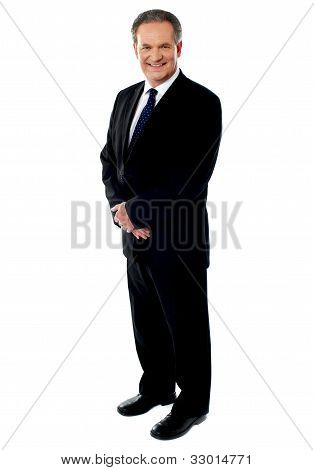 Full Length Portrait Of A Senior Businessman