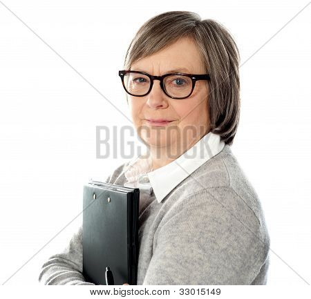 Attractive Old Orporate Lady Holding Business Document