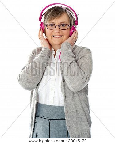 Attractive Old Lady Wearing Headphones