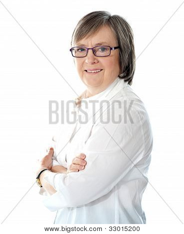 Side View Of Smiling Senior Female Manager