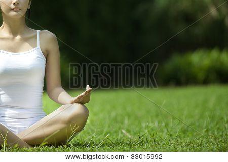 Beautiful Woman Meditating Outdoor