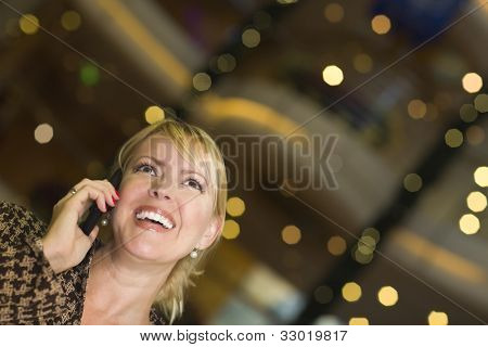 Beautiful Blonde Woman On Her Cell Phone in the City Lights.
