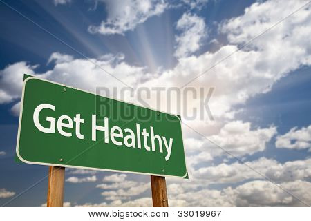 Get Healthy Green Road Sign with Dramatic Clouds, Sun Rays and Sky.