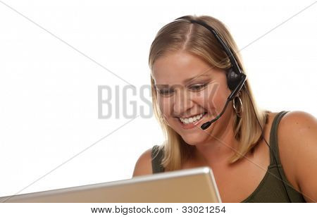 Beautiful Friendly Female Customer Support Phone Operator in Front of a Computer Screen Isolated on a White Background.