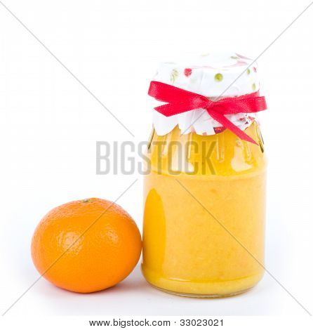 Jar with jam and Mandarin isolated on white background