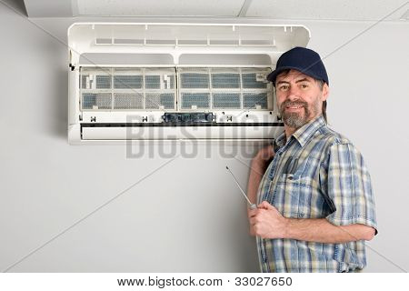 Repairer conducts adjustment of the indoor unit air conditioner