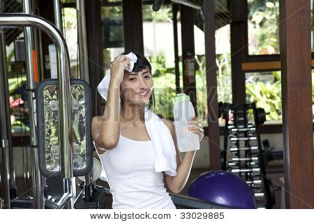 Healthy Beautiful Woman In A Fitness Club