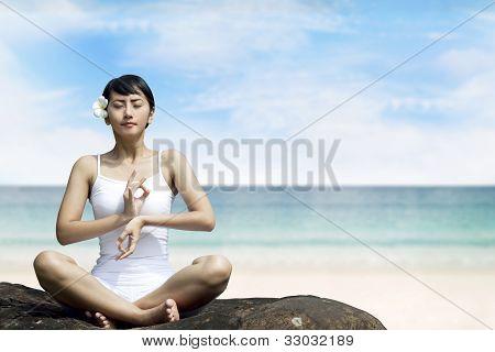 Beautiful Asian Woman Meditating At Beach