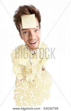 Wide angle shot of young man with a sticky note on his face, covered with yellow stickers, isolated on white
