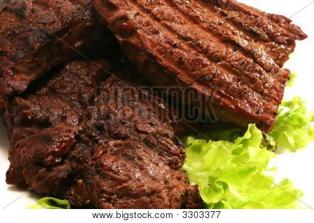 Grilled Beef Meat And Green Salad Over White