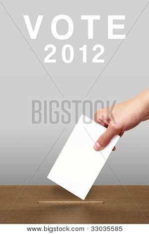 Hand Putting A Voting Ballot