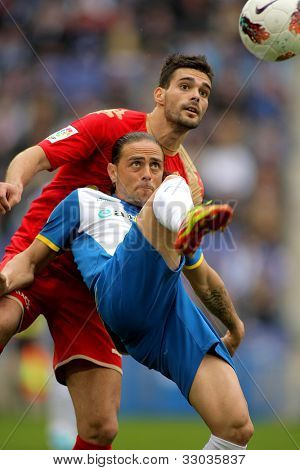 BARCELONA - APRIL 28:  Sergio Garcia(F) of Espanyol vies with Alberto Botia(B) of Sporting Gijon during a Spanish League match  at the Estadi Cornella on April 28, 2012 in Barcelona, Spain