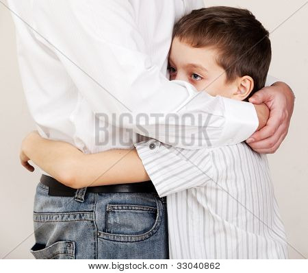 Father comforts a sad child. Problems in the family. Pain