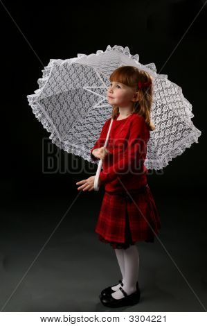 Girl In Red Holding A Parasol
