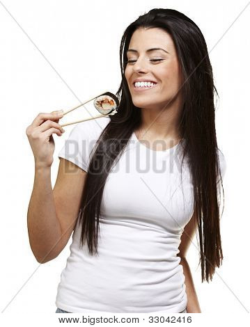 young woman eating a sushi piece against a white background