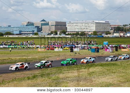 MOSCOW - JUNE 11: Race-cars stand on the track during 3-d tour in summer cup of Megafon mitjet race at Moscow racetrack MegaFon Tushino Ring, June 11, 2011, Moscow, Russia.