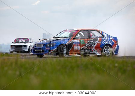 MOSCOW - JUNE 11: Racing car of V.Pustoshny on the track in 3-d tour in summer cup of Megafon mitjet race at Moscow racetrack MegaFon Tushino Ring, June 11, 2011, Moscow, Russia.