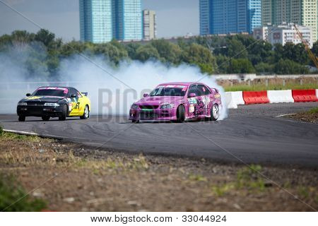 MOSCOW - JUNE 11: Racing cars of M.Kostyuchik and K.Izotov on the track in 3-d tour in summer cup of Megafon mitjet race at Moscow racetrack MegaFon Tushino Ring, June 11, 2011, Moscow, Russia.