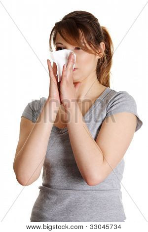 Sneezing Woman having cold or allergy. Isolated on white background.