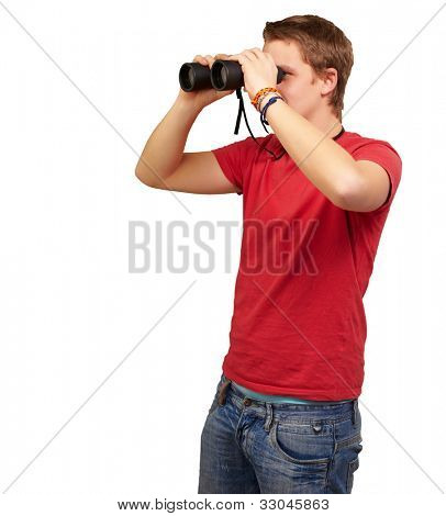 portrait of a young man looking through binoculars over a white background