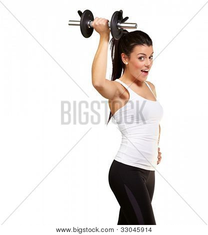 portrait of a young pretty woman holding weights and doing fitness against a white background