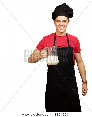 portrait of a young cook man holding a milk jar over a white background