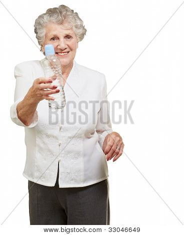 portrait of a healthy senior woman holding a water bottle over a white background