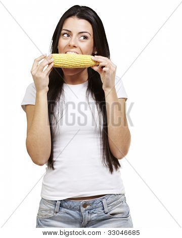 woman eating a delicious corncob against a white background