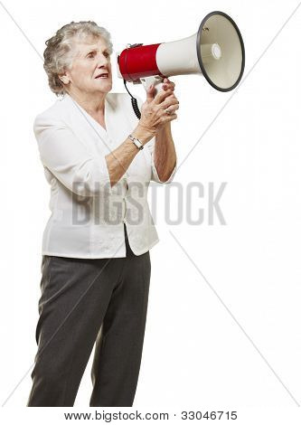 portrait of a senior woman holding a megaphone over a white background