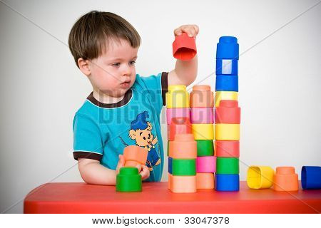 Two years child with colorful construction set