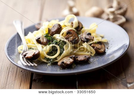 vegetarian dish with tagliatelles, spinach and mushrooms