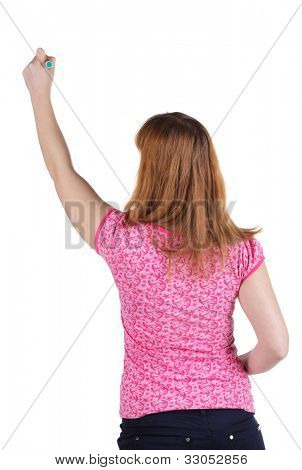 back view of writing beautiful brunette woman. Young girl draws. Rear view people collection.  backside view of person. Isolated over white background.