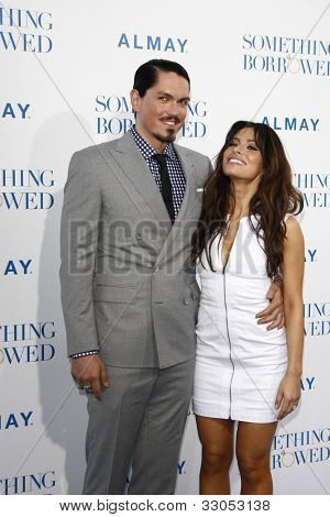 LOS ANGELES - MAY 3: Steve Howey, Sarah Shahi at the world premiere of 'Something Borrowed' at the Grauman's Chinese Theater in Los Angeles, California on May 3, 2011