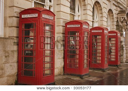 Four red phones boxes