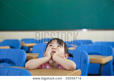 asian Little Girl are Thinking in the class room